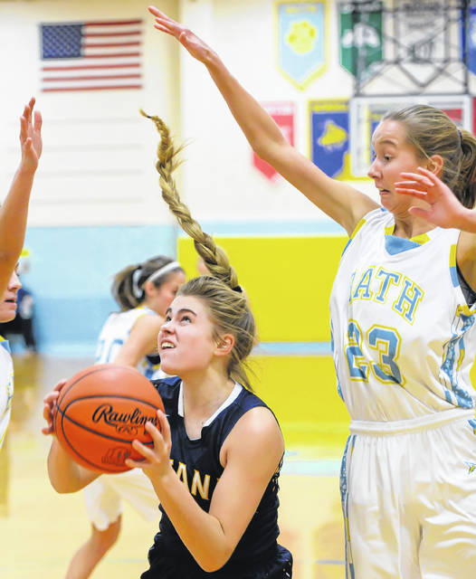 Ottawa-Glandorf's Kelsey Erford goes up for a shot against Bath's Ruby Bolon during Thursday night's Western Buckeye League game at Bath High School. See more girls basketball photos at LimaScores.com.