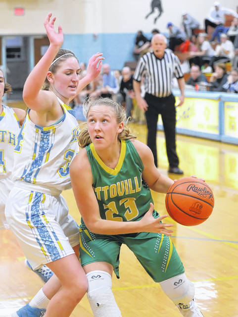 Ottoville's Kasey Knippen drives against Bath's Madelyn Renner during Tuesday night's game at Bath. See more girls basketball photos at LimaScores.com.