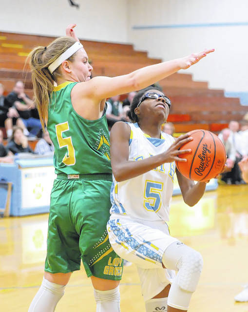 Bath's Ja'Dasia Hardison puts up a shot against Ottoville's Brynlee Hanneman during Tuesday night's game at Bath.