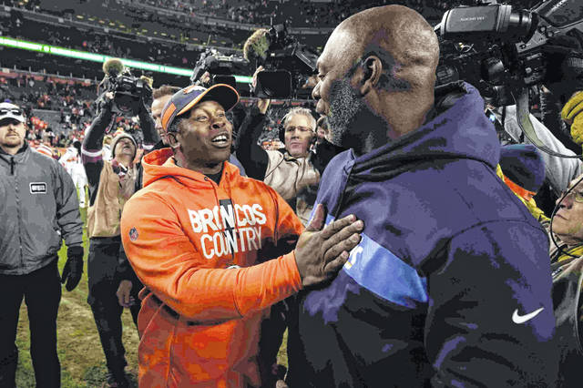 Denver Broncos head coach Vance Joseph, front left, greets Los Angeles Chargers head coach Anthony Lynn after an NFL football game, Sunday, Dec. 30, 2018, in Denver. (AP Photo/Jack Dempsey)