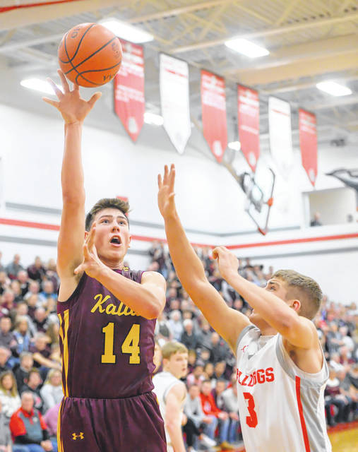 Kalida's Owen Recker puts put a shot against Columbus Grove's Tayt Birnesser during Friday's night Putnam County League game at Columbus Grove.