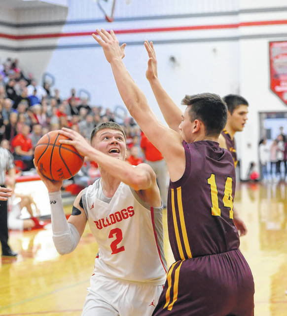 Kalida's Owen Recker defends against Columbus Grove's Blake Reynolds during Friday night's Putnam County League game at Columbus Grove High School.