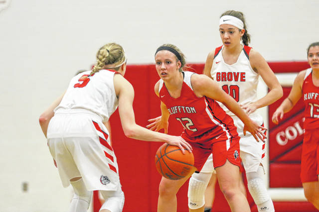 Columbus Grove's Erin Downing (10) looks to set a screen for Rylee Sybert against Bluffton's Katie Prater during Thursday night's Northwest Conference game at Columbus Grove.