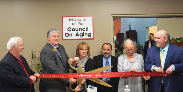 Lima-Allen County Chamber of Commerce President Jed Metzger cuts the ribbon for the new Allen County Council on Aging building at 700 N. Main St.