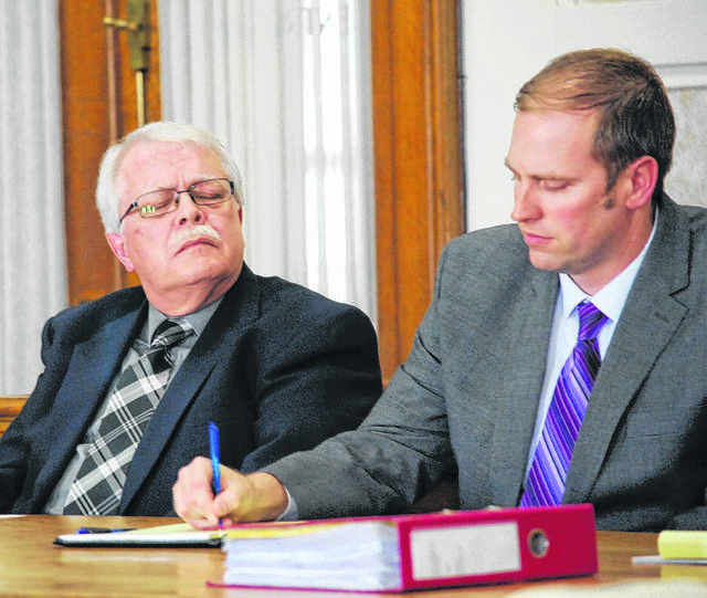 In this file photo, Dennis Dellifield, left, appears in Hardin County Common Pleas Court.