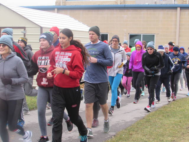 Runners participate in Putnam County YMCA Chilly 5K on New Years Day with proceeds going to track improvements.