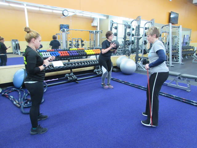 Anytime Fitness in Ottawa fitness instructor times Kelly Ridge, Pandora, and Geri Steffan, Leipsic, on exercises.