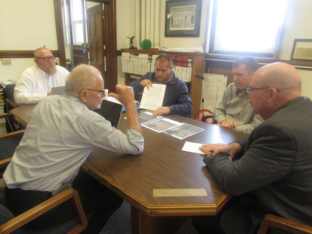 Clockwise, discussing a proposed wetland at the Putnam County Landfill to treat leachate, are Commissioners Vince Schroeder and Mike Lammers, Troy Recker, Bockrath and Associates project designer, and Greg Bockrath, Bockrath and Associates project engineer and John Schlumbohm, commissioner.
