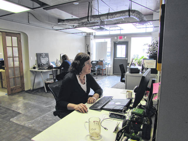 Marin Luria Harbur, a data scientist for Minnesota-based Land 'O Lakes, works from her desk rented at The Coworking Center, located inside The Meeting Place on Market in downtown Lima.