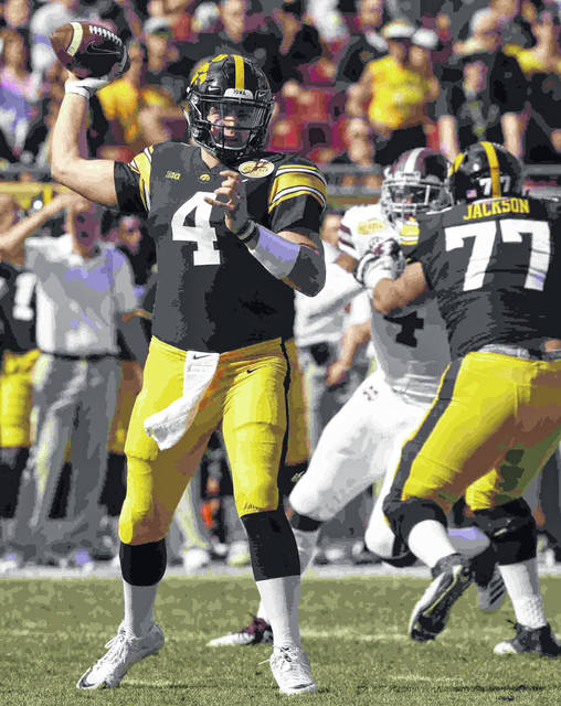 Iowa quarterback Nate Stanley (4) throws a pass against Mississippi State during the first half of the Outback Bowl NCAA college football game Tuesday, Jan. 1, 2019, in Tampa, Fla. (AP Photo/Chris O'Meara)