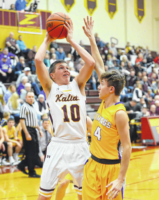 Kalida's Gabe Hovest putsup a shot against Leipsic's Wesley Garcia during Saturday night's Putnam County League game at Kalida High School.