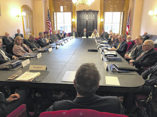 Outgoing Ohio Gov. John Kasich shares accounts of many of the biggest news events of the past eight years with members of his Cabinet. AP Photo/Julie Carr Smyth