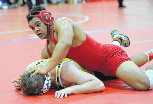 Bluffton's Deandre Nassar, right, competes against Troy Christian's Craig Montgomery during Saturday's Lima Central Catholic Thunderbird Invitational.