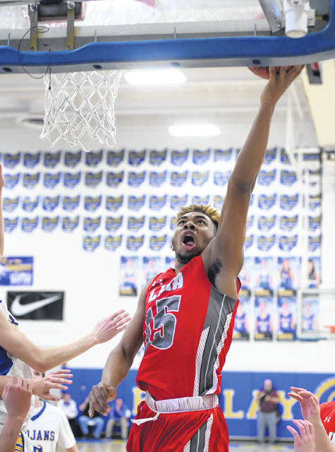 Lima Senior's Jamir Simpson puts up a shot during Friday night's Three Rivers Athletic Conference game at Findlay.