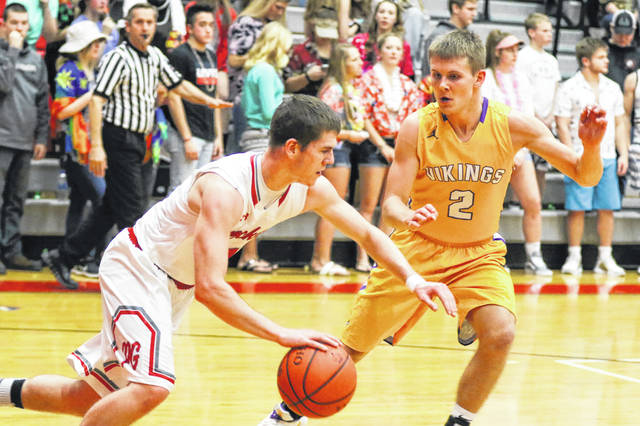 Pandora-Gilboa's Jared Breece tries to dribble past Leipsic's Cole Rieman during Friday night's game at Pandora Gilboa.
