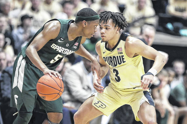 Purdue guard Carsen Edwards (3) defends Michigan State guard Cassius Winston (5) during the second half of an NCAA college basketball game in West Lafayette, Ind. on Sunday. Purdue defeated Michigan State 73-63.