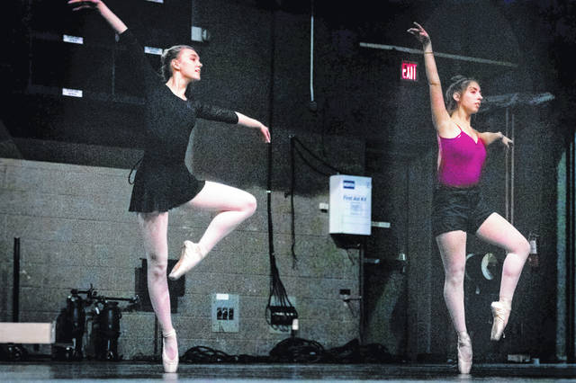 Abigail Long, (left) a sophomore musical theater major with minors in dance and administration from Medina, and Molly Van Gorp, (right) a freshman nursing major and dance minor from Powell rehearse for Ohio Northern University's Choreographers' Showcase.