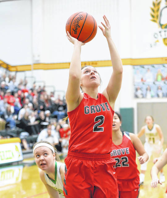 Columbus Grove's Angel Schneider puts up a shot against Ottoville's Brynlee Hanneman during Saturday's Putnam County League game at L.W. Heckman Gymnasium in Ottoville.