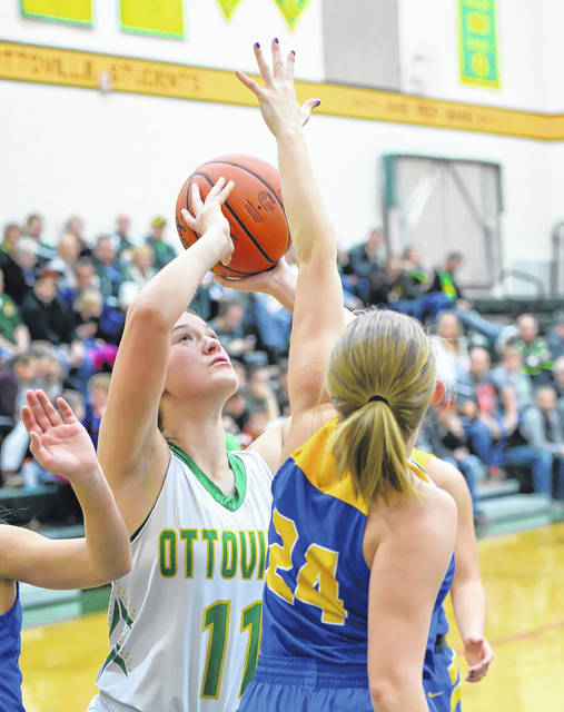 Ottoville's Peyton Wannemacher puts up a shot against Continental's Madelyn Potts during Thursday night's Putnam County League game at L.W. Heckman Gymnasium in Ottoville.