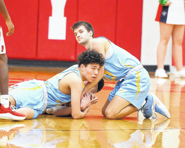 Bath's R.J. Cortez, left, and Josh Carman go to the floor for the ball with Perry's Bradley Walker during Tuesday night's game at Perry's Leonard V. Volbert Gymnasium.