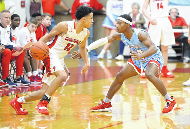 Perry's Jamal Whiteside, shown against Lima Central Catholic's Jeremy Allen Jr. earlier in the year, is averaging 18.6 points a game, 3.7 rebounds a game and 7.8 assists a game.