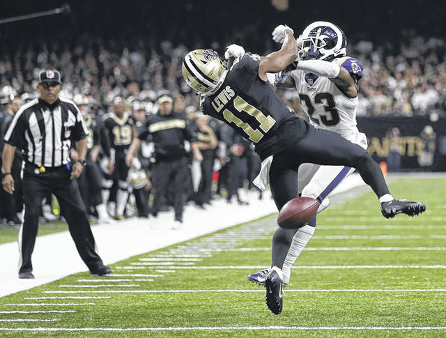 New Orleans Saints wide receiver Tommylee Lewis (11) works for a catch against Los Angeles Rams defensive back Nickell Robey-Coleman (23) in the most controversial play in the NFC championship game when pass interference was not called.