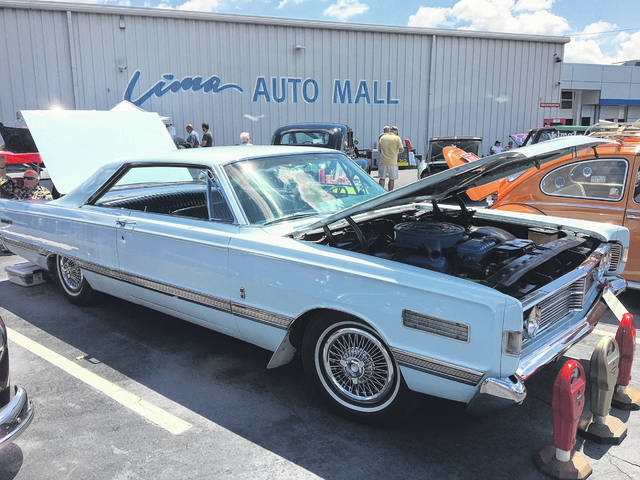 Sally Jo Bolenbaugh, of Rockford, picked this 1966 Mercury Park Lane out for her husband, Jerry, because she didn't like his former classic car, a 1977 Ford Ranchero. They've owned the car for 16 years.