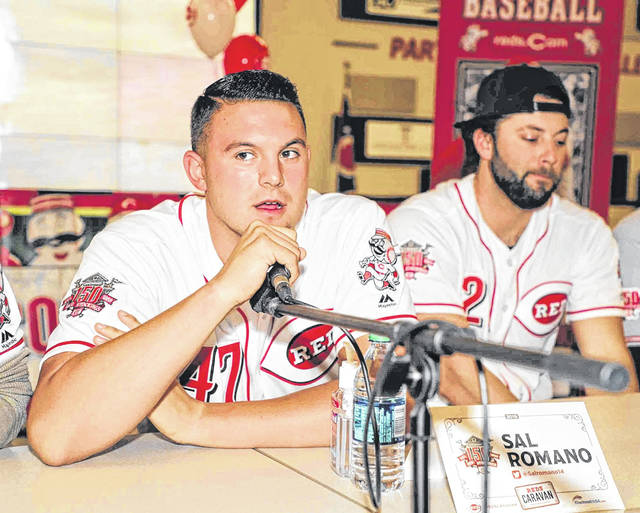 Cincinnati Reds pitcher Sal Romano answers a fan's question at the Reds caravan stop at Apollo Career Center in Lima last Friday.