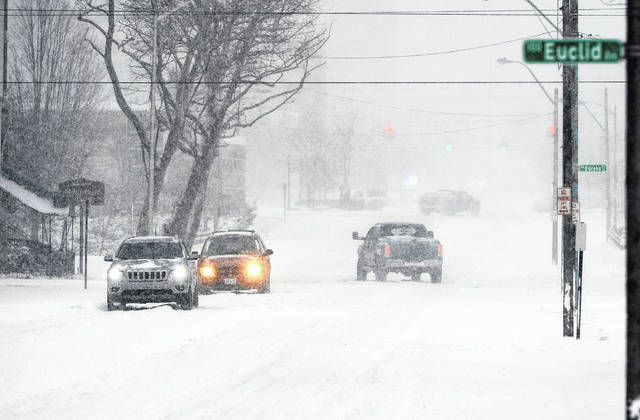 A winter storm that was expected to drop five to eight inches of snow caused slow traffic throughout the day Saturday.