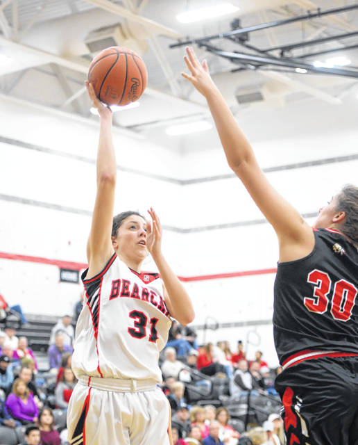 Spencerville's Nelaya Burden puts up a shot against Shawnee's Trinity Gearing during Tuesday night's game at Spencerville.