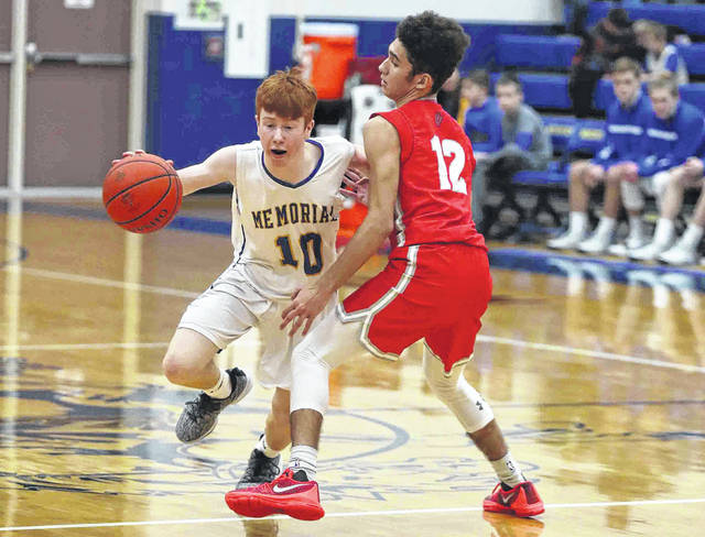 Van Wert's LeTrey Williams defends against St. Marys' Jack Cisco during Friday night's Western Buckeye League game at St. Marys.