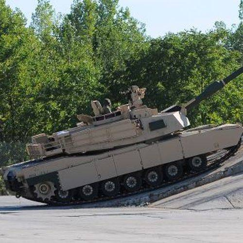 A M1A2 Abram tank perform a demonstration during Thursday's 10th Annual Journey to Remember to benefit for the Allen County Visionaries hosted by Lima General Dynamics Land Systems in Lima.     RICHARD PARRISH / The Lima News