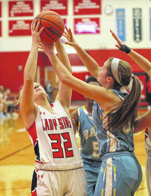 Wapakoneta's Jessica Davis (32) and Bath's Jordain Craig battle for a rebound during Thursday night's Western Buckeye League game at Wapakoneta.