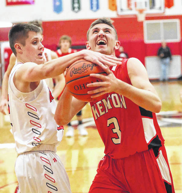 Wapakoenta's Noah Ambos defends against Kenton's Trey Jefferies during Friday night's Western Buckeye League game at Wapakoneta.