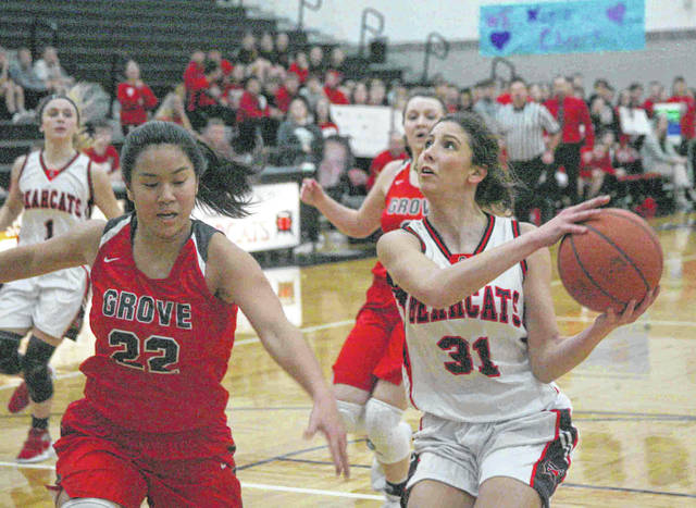 Spencerville's Nelaya Burden eyes the basket against Columbus Grove's Amy Vorst during Thursday night's Northwest Conference game at Spencerville.