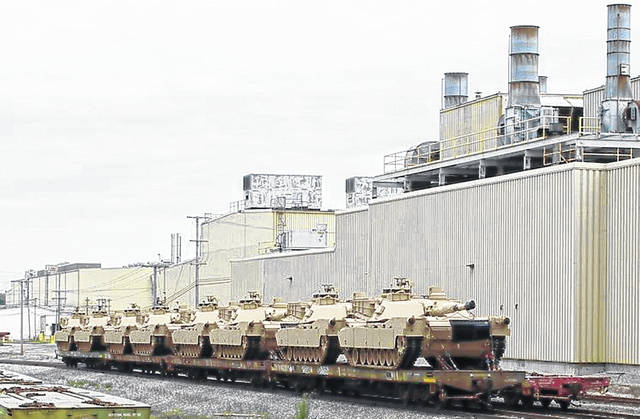 Abrams tanks overhauled at the Joint Systems Manufacturing Center in Lima are loaded on rail cars for shipment. American military power goes a long way toward ensuring global commerce and the American economy benefits hugely: 41 million American jobs depend on trade; U.S. manufacturers export some $1.3 trillion in goods annually. File Photo