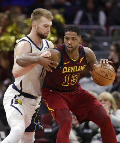 Indiana's Domantas Sabonis guards the Cavaliers' Tristan Thompson during Tuesday night's game in Cleveland. (AP photo)