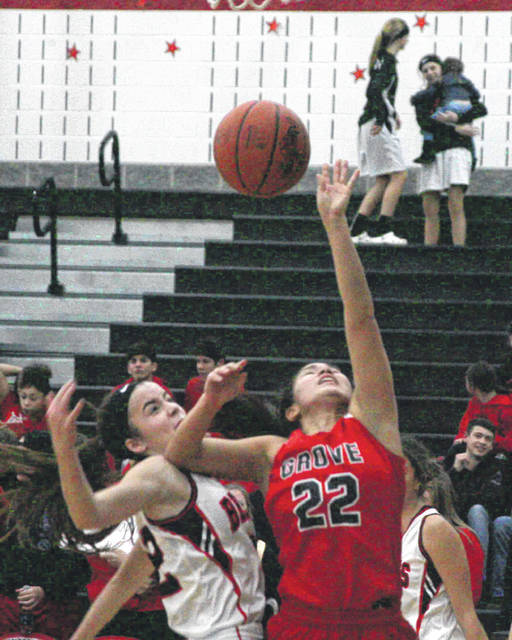 Columbus Grove's Amy Vorst puts up a shot during Thursday night's Northwest Conference game at Spencerville.