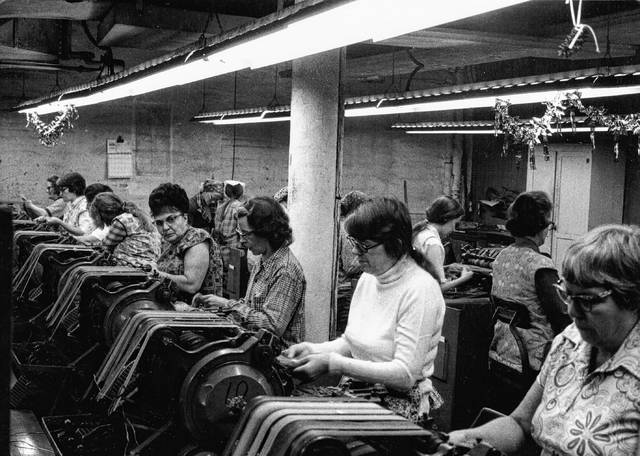 From right, Evelyn Wollum, Maxine Butler, Lillian Hammons and Virginia Rahrig work on the stemming or stripping machines in the 1970s. They would feed a leaf of tobacco into a machine that trimmed out the center stem.