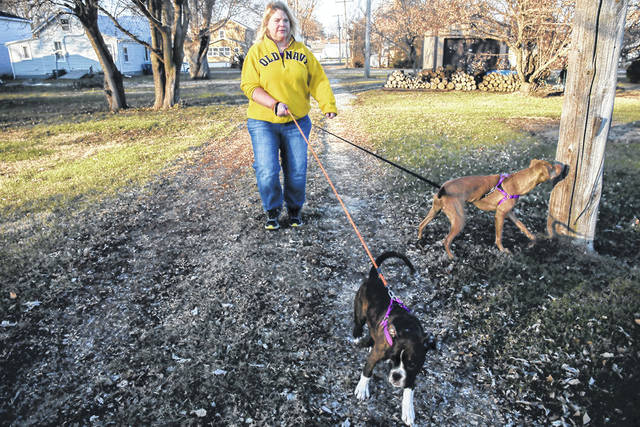 Danette Lake walks her dogs, Zoe and Chloe. A doctor told Lake that knee replacement surgery could reduce her arthritis pain by 75 percent. One year after the surgery, however, she's still in extreme pain and unable to work.