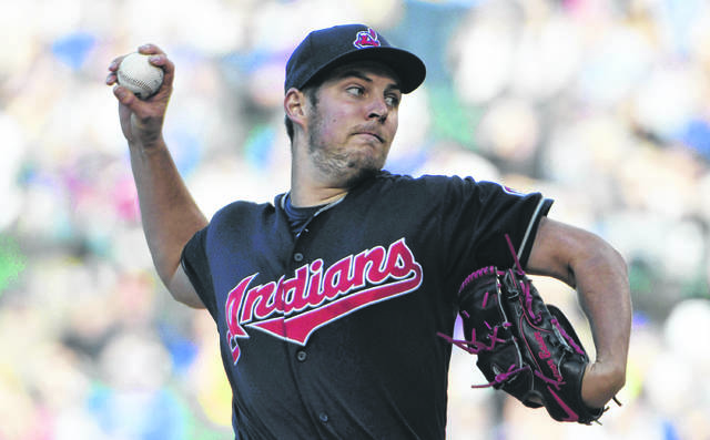 Cleveland's Trevor Bauer (47) throws against the Cubs during a game last season. Bauer will earn either $13 million or $11 million this season after he learns whether an arbitrator sided with him or the Indians in an arbitration decision.ion.