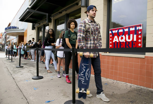 In this Tuesday, Nov. 8, 2016 file photo, voters wait in line to cast their ballots at the polling location in the University Co-op next to the University of Texas at Austin campus in Austin. On Friday, Feb. 1, 2018, The Associated Press has found that stories circulating on the internet that 58,000 non-citizens voted in Texas, are untrue. (Jay Janner/Austin American-Statesman via AP)