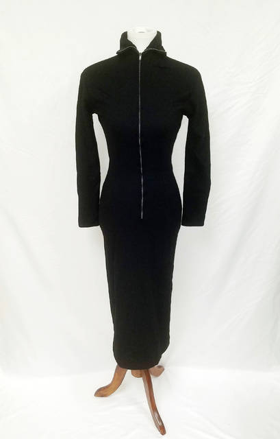 This undated image released by GWS Auctions shows a black dress that actress Marilyn Monroe wore to a 1954 press conference announcing her separation from baseball legend Joe DiMaggio. KruseGWS Auctions announced Wednesday that the simple wool dress with a zippered turtleneck front will be up for bidding starting on March 30. Monroe was wearing it in Beverly Hills on Oct. 6, 1954 when she stepped out amid a mob of cameras and reporters to announce the split in a marriage. (GWS Auctions via AP)