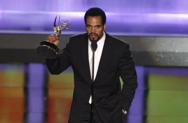 "FILE- In this June 20, 2008, file photo Kristoff St. John accepts the award for outstanding supporting actor in a drama series for his work on ""The Young and the Restless"" at the 35th Annual Daytime Emmy Awards in Los Angeles.  The ""Young and the Restless"" is remembering St. John with a series of special episodes. The CBS soap opera on Friday, Feb. 8, 2019, will broadcast a special tribute to the actor.  The 52-year-old died Sunday at his home in Los Angeles.   (AP Photo/Matt Sayles, File)"