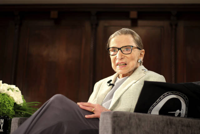 FILE - In this Saturday, Dec. 15, 2018 file photo, Supreme Court Justice Ruth Bader Ginsburg sits onstage as a speaker during an event organized by the Museum of the City of New York with WNET-TV held at the New York Academy of Medicine in New York. On Friday, Feb. 8, 2018, The Associated Press has found that stories circulating on the internet that she did not attend a Monday, Feb. 4, 2019 concert - her first public appearance in weeks, are untrue. (AP Photo/Rebecca Gibian)