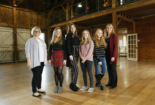 In this Jan. 31, 2019, from left, Westerville schools gifted coordinator Caley Nestor Baker, Westerville Central juniors Rachel Kaufman, Anna Borders, Sarah Gellner, Wellington junior Adriane Thompson and Genoa Middle School gifted facilitator stand inside the Everal Barn & Homestead in Westerville, Ohio. (Adam Cairns/The Columbus Dispatch via AP)