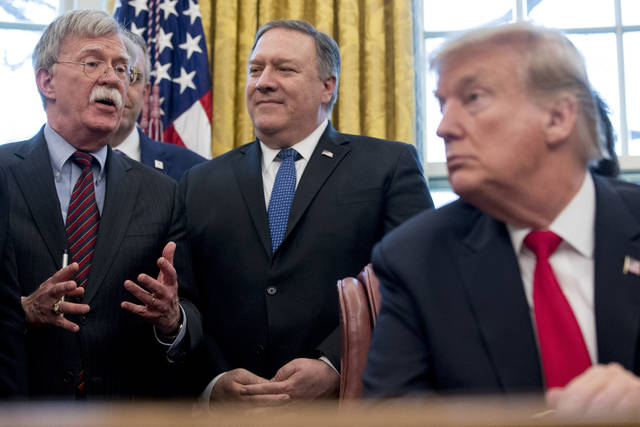 "From left, National Security Adviser John Bolton, accompanied by Secretary of State Mike Pompeo, and President Donald Trump, speaks before Trump signs a National Security Presidential Memorandum to launch the ""Women's Global Development and Prosperity"" Initiative in the Oval Office of the White House in Washington Thursday."
