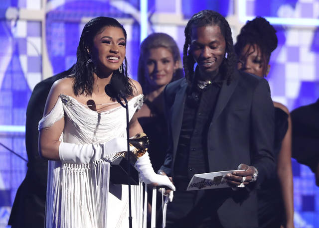 "Cardi B, left, accepts the award for best rap album for ""Invasion of Privacy"" as Offset looks on at the 61st annual Grammy Awards on Sunday in Los Angeles."