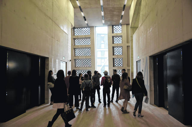 People stand in an area by the elevators in the new Switch House building extension to the Tate Modern gallery in London in June 2016. On Tuesday, neighbors of London's Tate Modern lost a legal fight to force the art gallery to close a viewing platform that gives visitors a view into their homes with large glass walls.