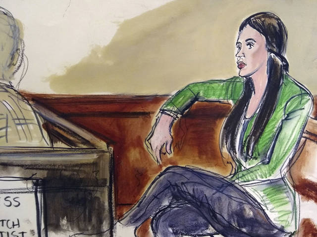 "In this courtroom drawing, Emma Coronel Aispuro, wife of Mexican drug kingpin Joaquin ""El Chapo"" Guzman, sits in the gallery listening, via earphones, to an interpreter reading a verdict in Spanish, Tuesday, Feb. 12, 2019, after a jury in New York, convicted her husband on drug conspiracy charges. (Elizabeth Williams via AP)"